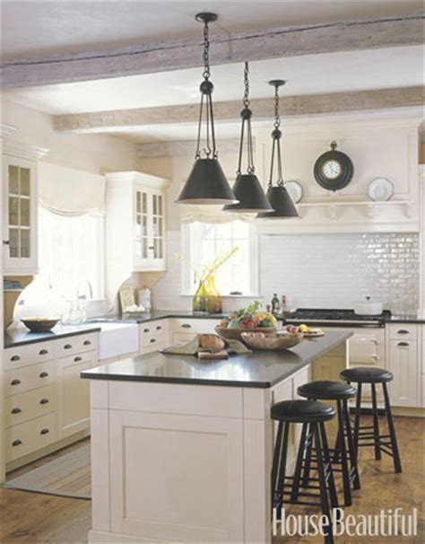 Lighting Above Kitchen Cabinets by Vancouver Interior Designer Which Pulls Knobs Should You
