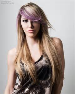 hair with long blonde hair with a purple streak in the side fringe