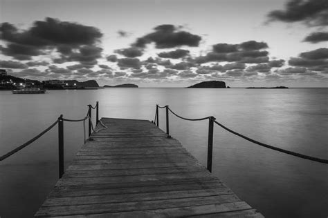 beautiful black  white ibiza coastal sunrise landscape