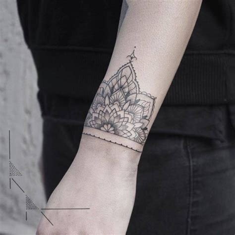 geometric wrist tattoo half mandala on the wrist by rachainsworth artist