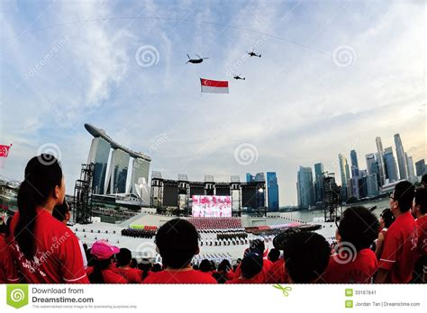 singapore s day spectators standing at attention as the national flag
