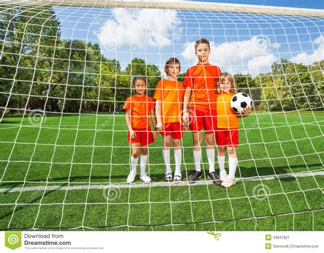 woodwork in football boy stand on the football field stock photography