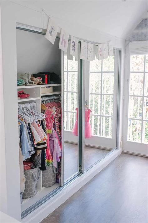 how to organize a closet with sliding doors well organized kid closet with mirrored doors transitional s room