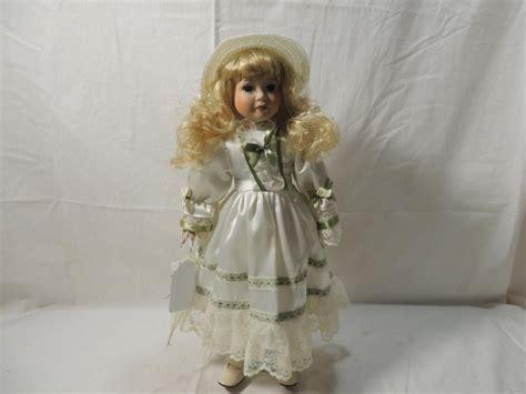 porcelain doll 18 18 quot porcelain doll in white green dress