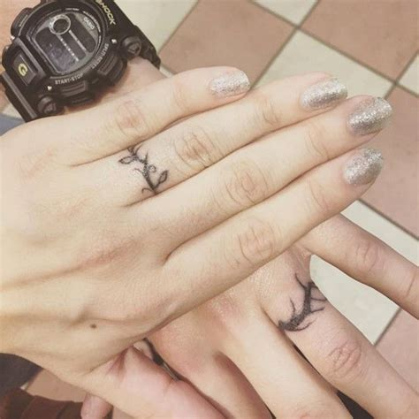 vine tattoo finger wedding ring wedding ring tattoos wedding ring tattoos