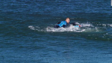 mick fanning foam board surfer mick fanning escapes shark attack cnn