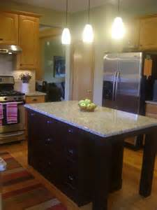 added a wood mode island granite countertops to