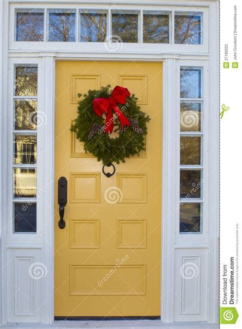 Bow Windows Prices yellow door with wreath stock photography image 27193222