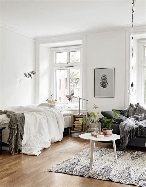 bed in living room decordots cosy vibes in a small scandinavian style apartment