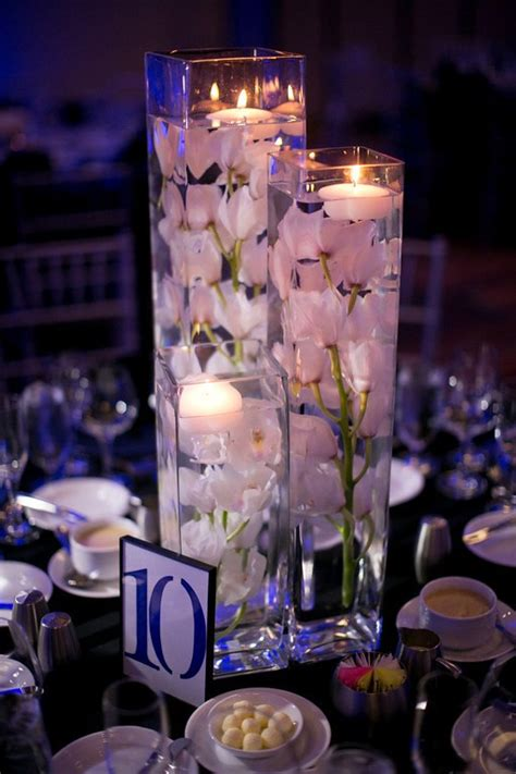 wedding centrepieces with floating candles 37 floating flowers and candles centerpieces shelterness