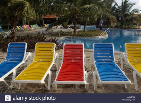 swimming bench colorful sunbathing sunbed benches near swimming pool at