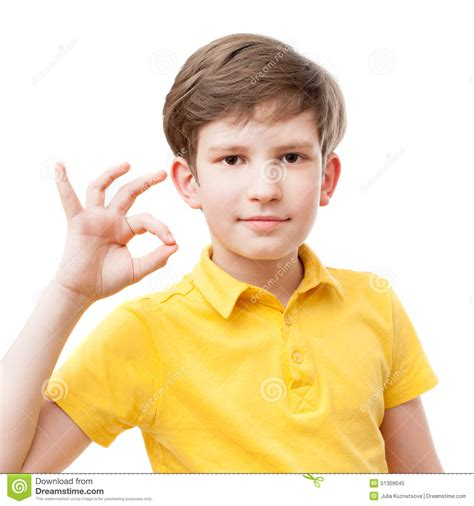 who is the little kid in the new geico commercial kid in yellow t shirt shows a gesture of ok stock photo