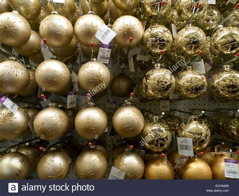 gold christmas baubles decorations price tags on display