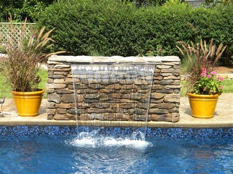 diy pool waterfall sheer descent waterfall into swimming pool water