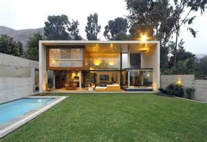 Glass And Concrete House by Hanging Rooms Inside Of A Concrete Frame House By