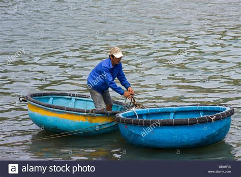 round boat fisherman in traditional round boat vinh hy vietnam