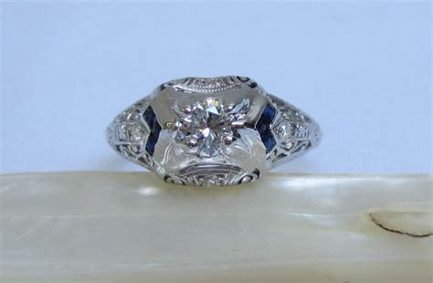vintage engagement ring with sapphire accent