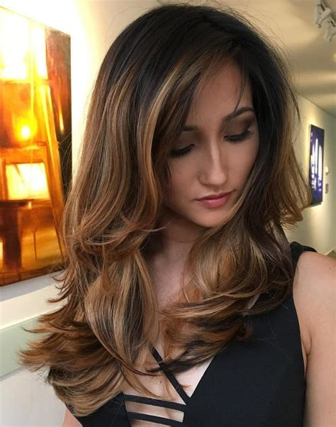 thick wavy hair thats layered and looks chopped up cute long layered haircuts for wavy hair with highlight