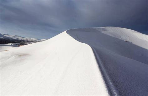 sahara desert snow cold snap brings snowfall to the sahara desert for the