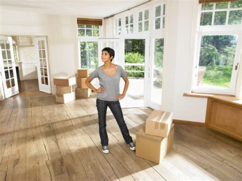 moving into a new house women moving into new house stock photo getty images