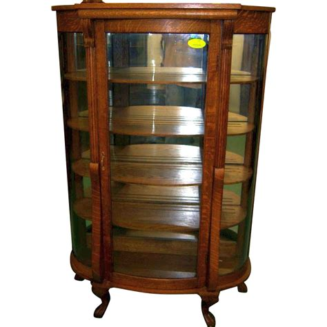 Oak Curved Glass China or Curio Cabinet from robertsantiques on Ruby Lane