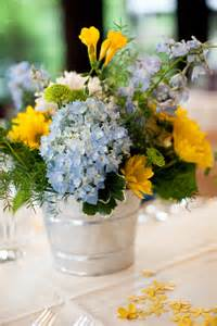 blue and yellow centerpieces country wedding flowers dandelions flowers gifts