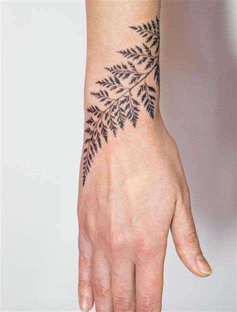 tattoo around wrist 50 amazing wrist tattoos for men women fern tattoo