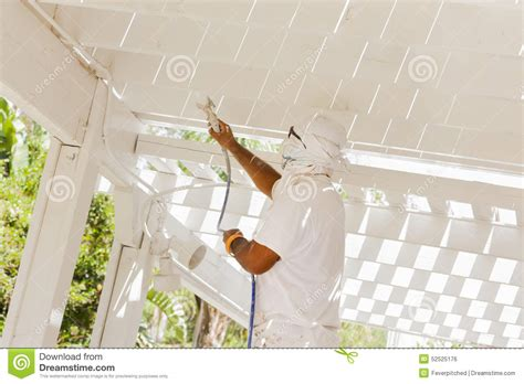spray painting in the house painter spray painting royalty free stock photo