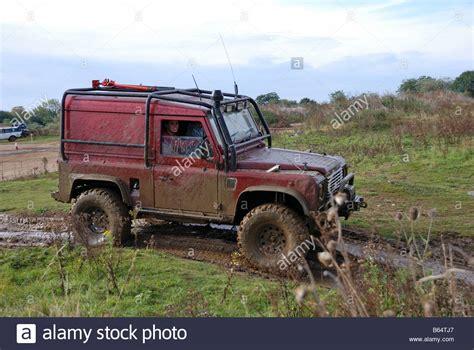 Stiker Mobil Defender 90 Pernik Offroad 4x4 mud splattered land rover defender 90 kitted out for road work stock photo royalty free