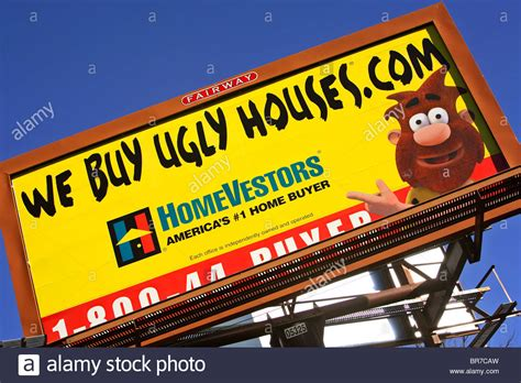 we buy ugly houses we buy ugly houses a homevestors billboard in asheville nc stock photo royalty free