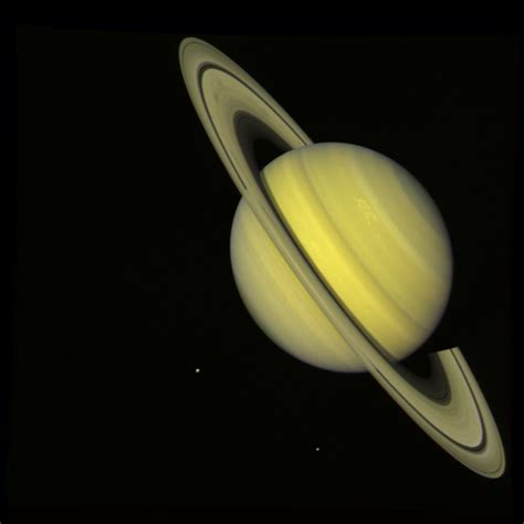 saturn colors space images saturn with rhea and dione true color