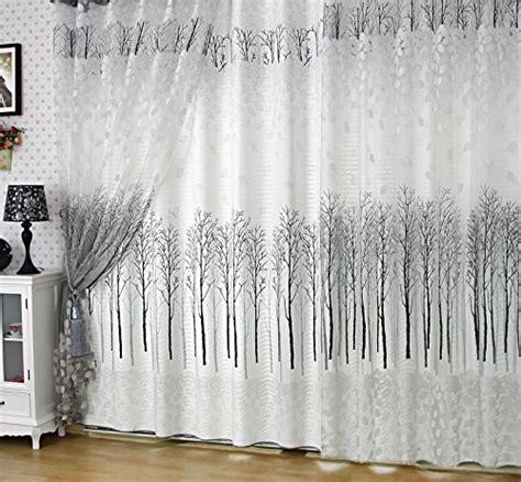 elleweideco modern white and black tree branch window