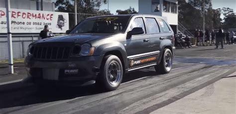 racing jeep grand turbo jeep grand srt8 goes drag racing aims