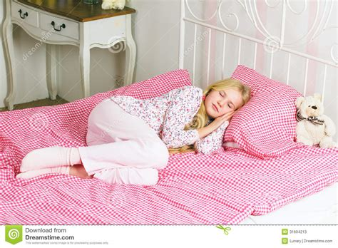 little girl bed little girl sleeping in bed stock photos image 31604213
