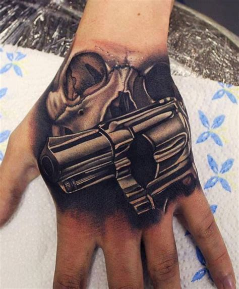 hand tattoo uk skull gun tattoo sleeve tattoos pinterest hands