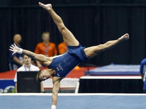 ex michigan sam mikulak leaps to men s gymnastics