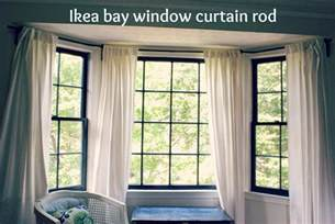 Bay Window Drapes Between Blue And Yellow Bay Window Curtain Rod