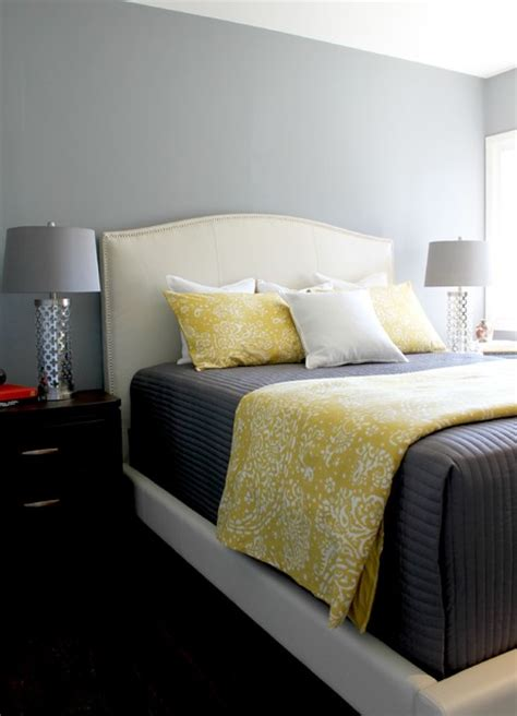 white yellow and grey bedroom gray yellow and white bedding on a white upholstered bed