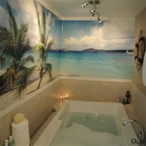 wild bathrooms going wild with coastal wallpaper in the bathroom