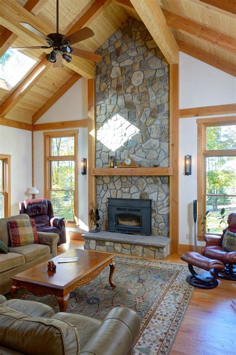 family room with vaulted ceiling and fireplace the
