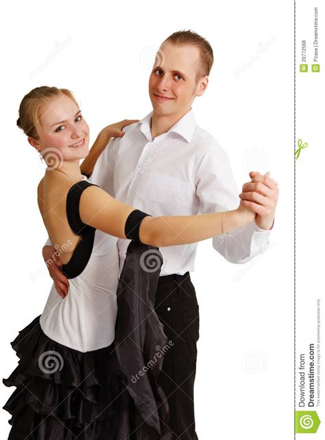 Young couple dancing in the living room