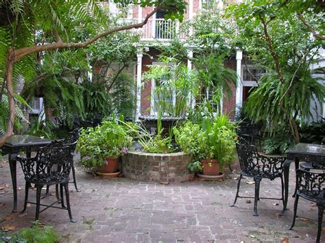 court yards classic fountain planted heavily in french quarter