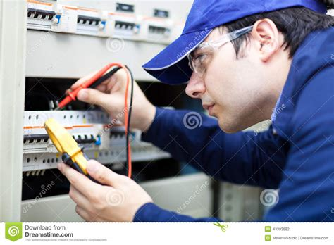 professional electrician at work stock photo image 43393682