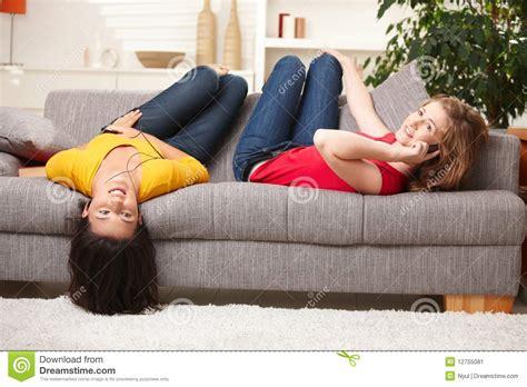 having on the sofa teenage girls having fun at home stock image image 12755081