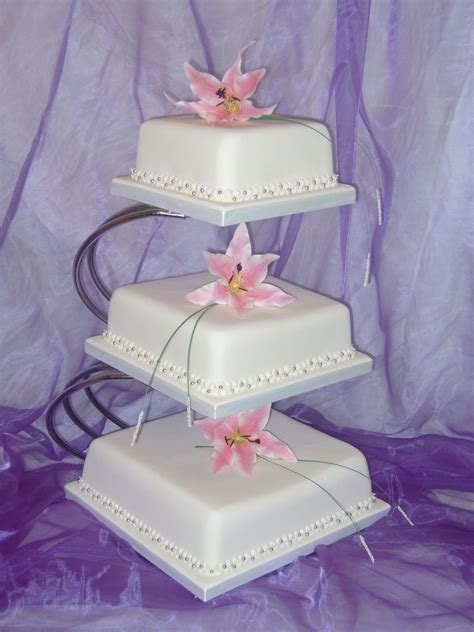 wedding cake three tier stand 3 tier square wedding cake with lillies on stand cakes
