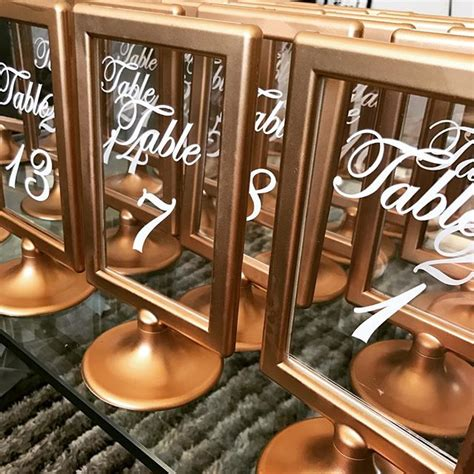gold table number frames gold frame and acrylic table numbers npm events