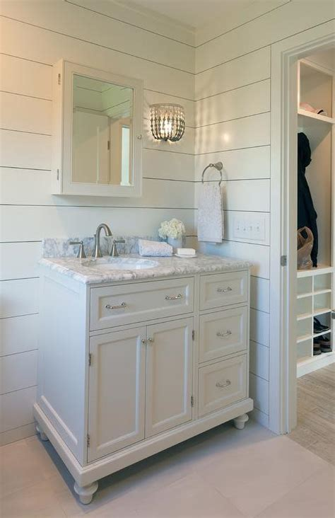 gray beaded wall sconce  shiplap bathroom walls