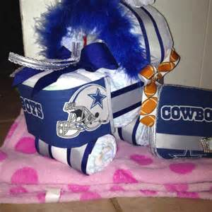 a diaper cradle and wipey case in dallas cowboy matching print done by me my own work