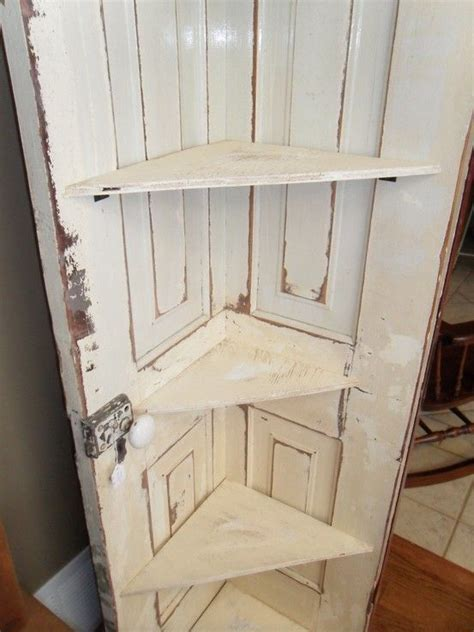 how to make an old door into a headboard old door cut in half and turned into a corner shelf