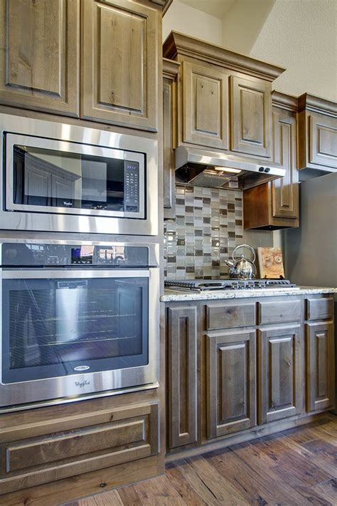 medium brown kitchen cabinets gehan homes kitchen medium brown cabinets tile
